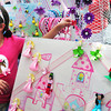 """Newburyport: Kayla Romaides, 8, of Byfield checks out some headbands and """"hair whimsy"""" at the Market Square Craft Show. Crafter Lisa Gedaminsky of Lisa Made It is the artistan who makes the pieces. Bryan Eaton/Staff Photo"""
