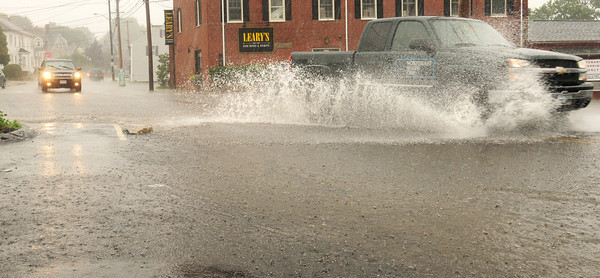 Newburyport: Yesterday's heavy rain caused flooding in the area, here at the bottom of Kent Street at Merrimac Street in Newburyport. Sun returns for the rest of the week, though showers are still possible. Bryan Eaton/Staff Photo