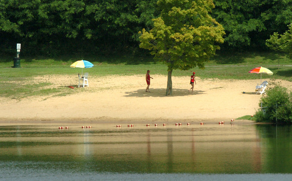 Amesbury: Despite the weather being warm and muggy Monday, the only people at Lake Gardner Beach in Amesbury were two lifeguards in the afternoon. Bryan Eaton/Staff Photo