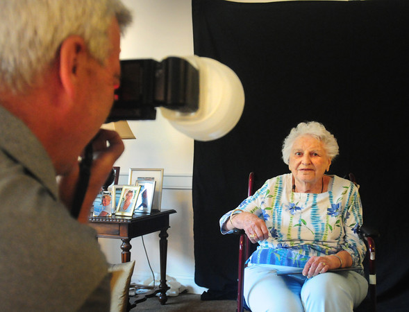 """Newburyport: Dora Sullivan, who turned 100 last week, gets her """"glamour"""" photo taken by photographer Rick Dumont after receiving her facial and makeup at Atria Merrimack Place on Tuesday. The senior living facility hosted Gorgeous Grandma Day as they """"promote the new face of aging and belief in the potential of senior citizens."""" Bryan Eaton/Staff Photo"""