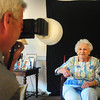 "Newburyport: Dora Sullivan, who turned 100 last week, gets her ""glamour"" photo taken by photographer Rick Dumont after receiving her facial and makeup at Atria Merrimack Place on Tuesday. The senior living facility hosted Gorgeous Grandma Day as they ""promote the new face of aging and belief in the potential of senior citizens."" Bryan Eaton/Staff Photo"