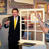 Amesbury: Ron Fuller, right, who closed his family's landmark clothing store in Amesbury, was given a toast, reluctantly, by the community  and the Amesbury Chamber of Commerce and Industry on Monday night. Chamber president Melissa LaChance, left, and artist Jon Mooers helped to organize the event. Bryan Eaton/Staff Photo