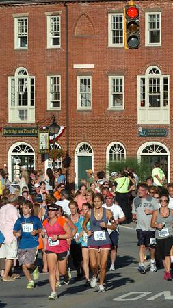 Newburyport: Runners in the Yankee Homecoming 5K Road Race through head through Newburyport's Market Square. Bryan Eaton/Staff Photo