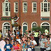 Newburyport: Runners in the Yankee Homecoming 5K Road Race through head through Newburyport's Market Square. Bryan Eaton/Staff Photo