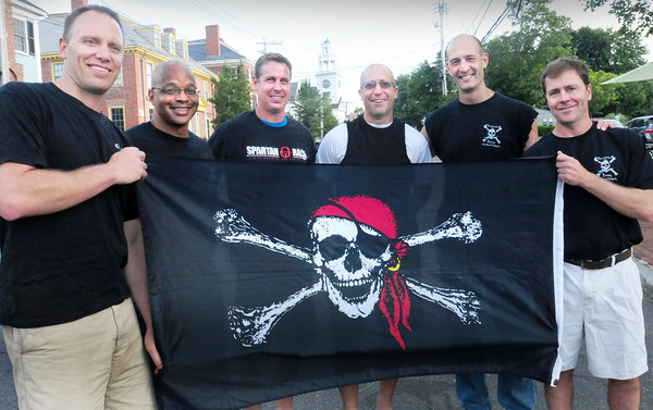 """Newburyport: The """"Pirates of the Merrimack"""" hold the course record for the Yankee Homecoming Bed Race. From left, Hans Schonemann, Gary Davis, Patrick Ward, Chris Heline, Jake Vartabedian and Matt Langis. Bryan Eaton/Staff Photo"""