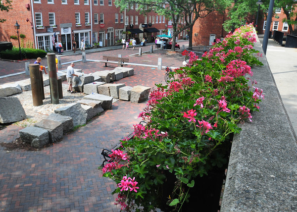 Newburyport: New planters have been installed on the upper walkway on Inn Street in downtown Newburyport. The Newburyport Downtown Enhancment Team, made up of merchants, citizens and people with love for the city, have been raising funds for the improvement. Bryan Eaton/Staff Photo