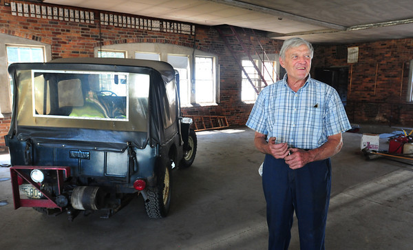 Amesbury: Philip Michaud, 83,  reflects on his years as owner of Michaud's Garage on Friend Street in Amesbury which was closed for good yesterday. The jeep to left he bought new in 1949 was using it to plow snow as of last winter. Bryan Eaton/Staff Photo