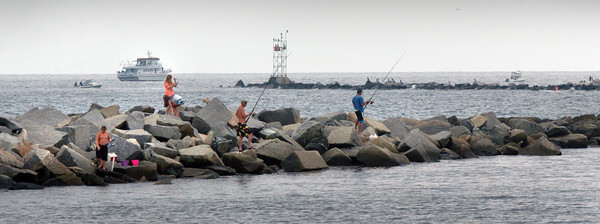 Salisbury: Whether people were on the north jetty of Salisbury Beach, on a private or party boat, many were out fishing on Tuesday afternoon. Bryan Eaton/Staff Photo