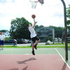 Newburyport: Isaac French, 14, goes for a layup at Cashman Park on Wednesday. He and this brother, Jacob, 11, of Newburyport were taking lessons from Evan Petty, left, of Community Hoops. Bryan Eaton/Staff Photo