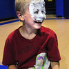 "Salisbury: Evan Zamer, 6, of West Newbury laughs after smashing a plate of whipped cream in his own face at the Boys and Girls Club in Salisbury. It's Goo Week and the children played a kind of game like musical chairs passing the whipped cream ""pie"" around until the music stopped, and then whoever was holding the plate got ""hit."" Bryan Eaton/Staff Photo"