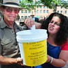 Newburyport: John Ashton, left, and Tammy Jennings Co-chairman of Yankee Homecoming chose the winners of the 50/50 Raffle held to raise money for the fireworks display last year. File Photo