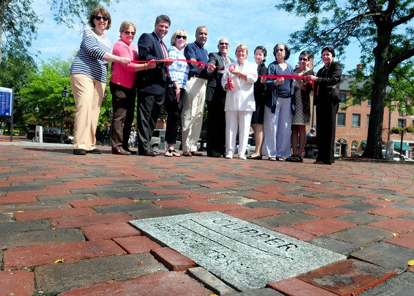 Newburyport: Supporters and officials attended the official opening of the the Clipper Heritage Trail in Newburyport's Market Square on Wednesday. From left, Pat Conley, Trisha Ferguson, Mark MacBurnie, Ann Ormond, Sheriff Frank Cousins, Tim Felter, Ghlee Woodworth, state Sen. Kathleen Ives O'Connor, Ruth Allen, Eleanor Bachrach and Newburyport Mayor Donna Holaday. Bryan Eaton/Staff Photo