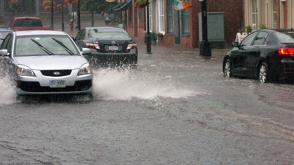 Newburyport: Newburyport's Market Square turned into a lake as the heavy rains swept through the area creating local flooding. Bryan Eaton/Staff Photo