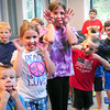 Amesbury: Youngsters make funny faces on the command of balloon artist Professor Jungle Flick at the Costello Transportation Center in Amesbury as he gets them warmed up. The event was a Harry Potter Balloon Party on of the events of Kids' Summer Reading by the Amesbury Public Library. Bryan Eaton/Staff Photo