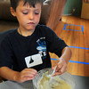 Newburyport: Charlie Shanley, 4, takes his turn mixing pancake batter at the Kelley School on Monday which he was going to top with blueberries, strawberries and chocolate chips. The Little Aces camp, put on by Newburyport Youth Services, are having their Chef's Academy this week reading food-related books and then making some food. Bryan Eaton/Staff Photo