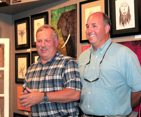 Amesbury: Ron Fuller introduced Mike Dumaresq, who bought his building in downtown Amesbury, earlier this week at a toast in Fuller's honor. Bryan Eaton/Staff Photo