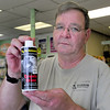 Salisbury: Tim Lamprey of Harbor Gardens has bottles of coyote urine to ward of woodchucks. Bryan Eaton/Staff Photo