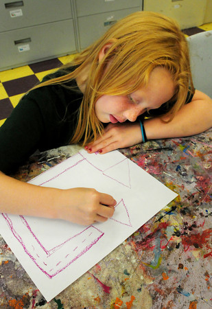 Salisbury: Destiny Choquette, 7, of Amesbury draws a treasure map from her home to the Boys and Girls Club in Salisbury where she's in the art room. This is Pirate Week at the club where they will be doing different activities as a scavenger hunt. Bryan Eaton/Staff Photo