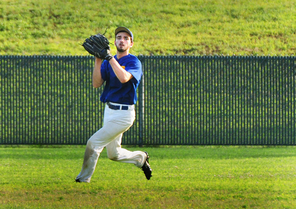 Rowley: Rowley Rams centerfielder Dmitri Hunt catches a Manchester fly ball. Bryan Eaton/Staff Photo