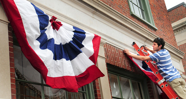 Newburyport: Kyle Mooers, and his brother Ryan, were busy setting up bunting in downtown Newburyport on Thursday as the city readies for Yankee Homecoming. Bryan Eaton/Staff Photo
