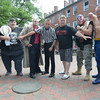 "newburyport: Wrestlers: Bugsy Stone, Big Woody, Champaigne"" Joe Moakley,  Daryl Mitchell, Ed Hunt, ""Big Gun"" Jim Sargent, Ace Adams,and The Hampton Beach Bad Boy, pose in Markey Square in Newburyport. They will be wrestling at Yankee Homecoming. Jim Vaiknoras/staff photo"