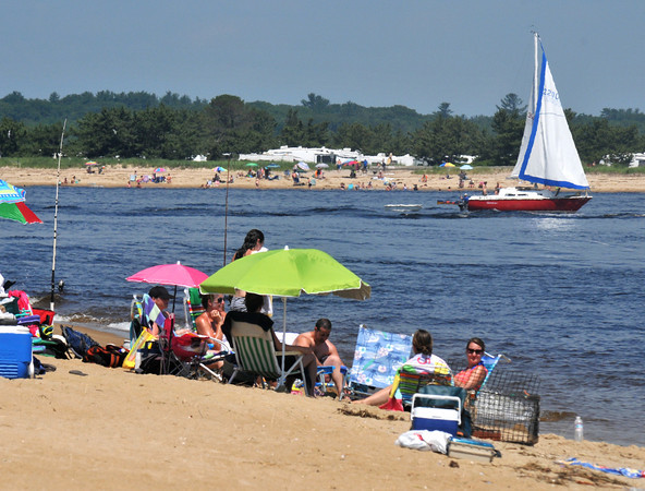 Newburyport: Beach goers cool off on both sides of the Merrimack River as seen from Plum Island Point Friday afternoon. Jim Vaiknoras/staff photo