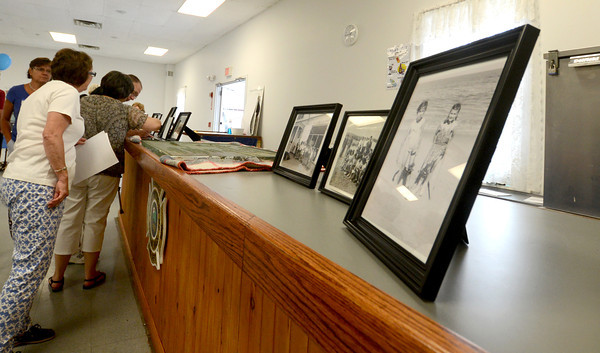 Newbury: People look over old photos at the Camp Seahaven Reunion at Fireman's Hall in Newbury.