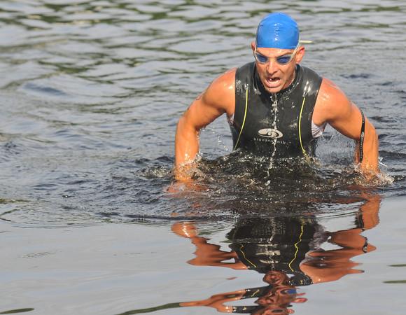 Amesbury: Vin Miserandino head out of the water during the Dam Triathlon Saturday morning in Amesbury. Jim Vaiknoras/staff photo