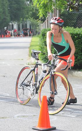Amesbury: Maureen Moore of Newbury hopes off her bike during the Dam Triathlon Saturday morning in Amesbury. Jim Vaiknoras/staff photo