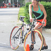 Amesbury: Maureen Moore of Newbury hopes off her bike during the Dam Triathlon Saturday morning in Amesbury. Jim Vaiknoras/staff photo