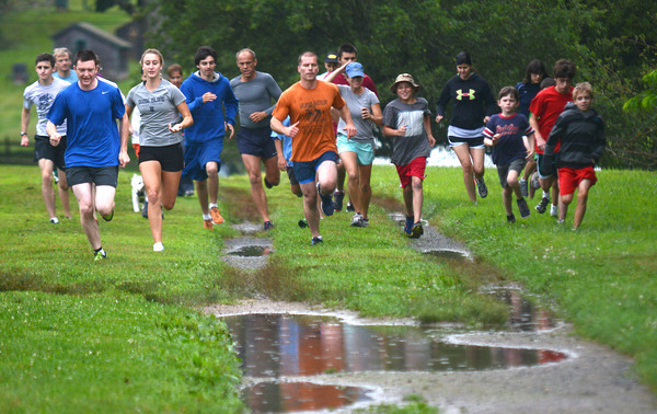 Newburyport: Runners take off in the Maudslay Cross-Country Series Thursday night. Jim Vaiknoras/staff photo
