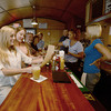 Salisbury: Patrons Lauren Walunas, Meghan Monahan, Doreen and Kerry Kane are served by Conor McLaughlin, Amy Damato, and Suzanne Dun at The Deck in Salisbury. Jim Vaiknoras/staff photo