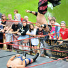 "Newburyport: Atlantic Pro Wrestler the International Super Star flies off the ropes at Mark ""The Sure Thing"" Shurman during their match at Old Fashioned Sunday. Jim Vaiknoras/staff photo"