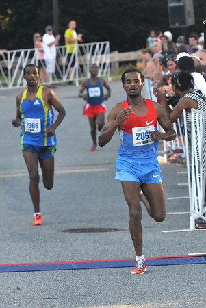 newburyport: Aschalew Mekete wins with Mengistu Nebsi and Tariku Bokan just behind in the Yankee Homecoming 10 mile race Tuesday night. Jim Vaiknoras/staff photo