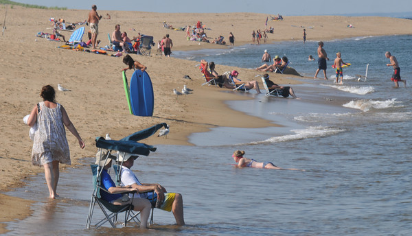 Newbury: Seakin relief from the hot weather, people cool off in the ocean off Plum Island. Jim Vaiknoras/staff photo