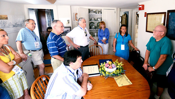Salisbury: Paul Turner , right, talks about the Pikes in Salisbury at he Salisbury Historical society to members of the Pike family at the families reunion Friday.Jim Vaiknora/staff photo