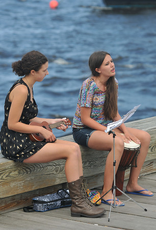Newburyport: Katherine Lacey on the ukulele and Fiona Hill on the drum perform along the boardwalk in Newburyport Sunday afternoon. Jim Vaiknoras/staff photo