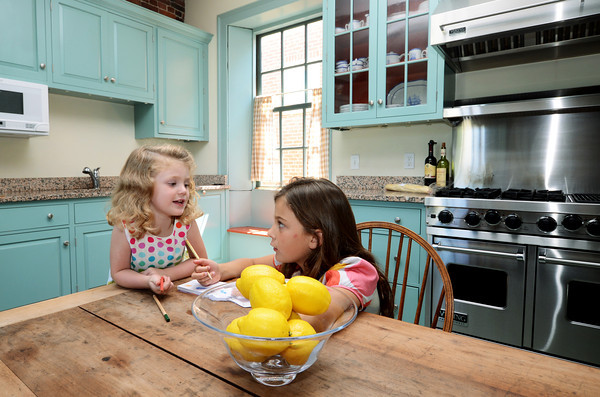 Newburyport: Blaire, 4, and her sister McKenzieFox, 8, in their kitchen at 17 Federal Street in Newburyport.The kitchen is being featured in the annual Kitchen Tour. Jim Vaiknoras/staff photo