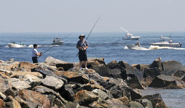 Newburyport: Boats fill the mouth of the Merrimack River as fishermen try their luck off the South Jetti on a hot July day. Jim Vaiknoras/staff photo