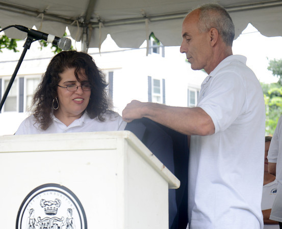 Newburyport: Yankee Homecoming General Chairman Tammy Jennings recieve her jacket from last years chairman David Chretien at Old Fashion Sunday. Jim Vaiknoras/staff photo