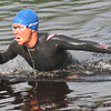 Amesbury: Marnie Lawler of Essex explodes out of the water at Lake Gardner during the Dam Triathlon Saturday morning in Amesbury. Jim Vaiknoras/staff photo