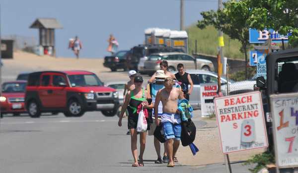 Newbury: People carry their gear bake from a day at the beach on Plum Island. Jim Vaiknoras/staff photo