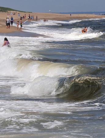 Newbury: People take advantage of the beautiful weather in Plum Island surf Friday afternoon. Jim Vaiknoras/staff photo