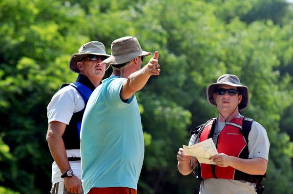amesbury: Eric Adelstein, David Singer, and Chris Richardson discuss a plan of attack for the inaugural Lake Gardner Canoe-O Canoe, Kayak and SUP Orienteering Adventure Race Saturday. Jim Vaiknoras/staff photo