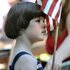 Amesbury: Elizabeth Ashkinazi, 5, holds the flag in her red, white and blue dress at Pancakes in the Pines in Amesbury Thursday morning. Jim Vaiknoras/staff photo