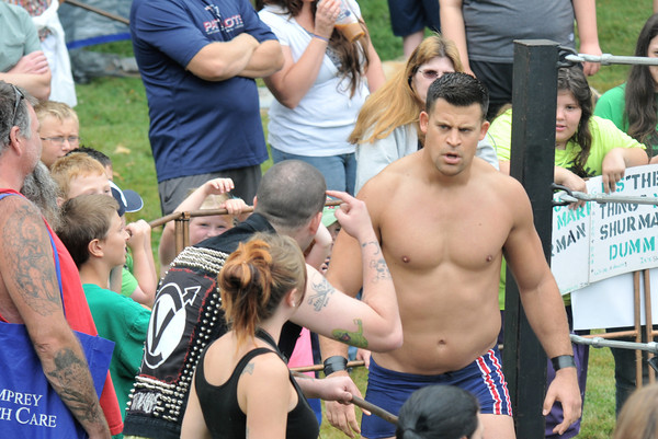 "Newburyport:A fan questions the high cognitive functions of Atlantic Pro Wrestler Mark ""The Sure Thing"" Shurman at Old Fashioned Sunday. Jim Vaiknoras/staff photo"