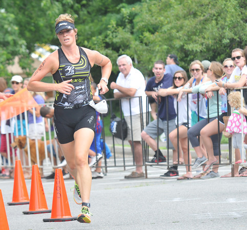 Amesbury: Danielle Baker heads out running during the Dam Triathlon Saturday morning in Amesbury. Jim Vaiknoras/staff photo