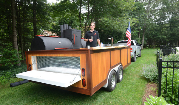 Rowley: Chris Breen owner of Que N' Brew in his mobil beer tap/BBQ/ Smoker in Rowley. Jim Vaiknoras/staff photo