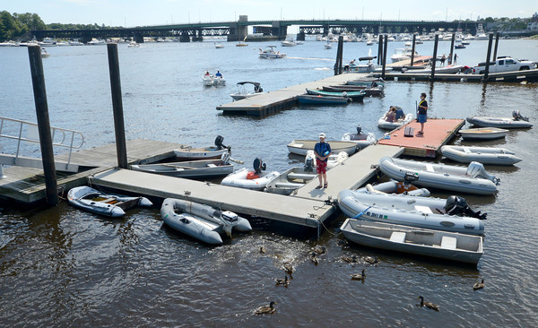 Newburyport; Boaters, launches and ducks gather near the boat ramp at Cashman Park in Newburyport Sunday. Jim Vaiknoras/staff photo