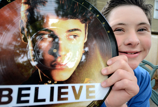 newburyport: Jared Bedard with a record he got at the Justin Bieber concert Saturday night. Jim Vaiknoras/staff photo